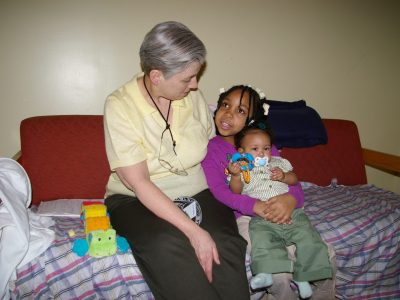 Sr. Pat Rogan with the two children of one of her past clients.