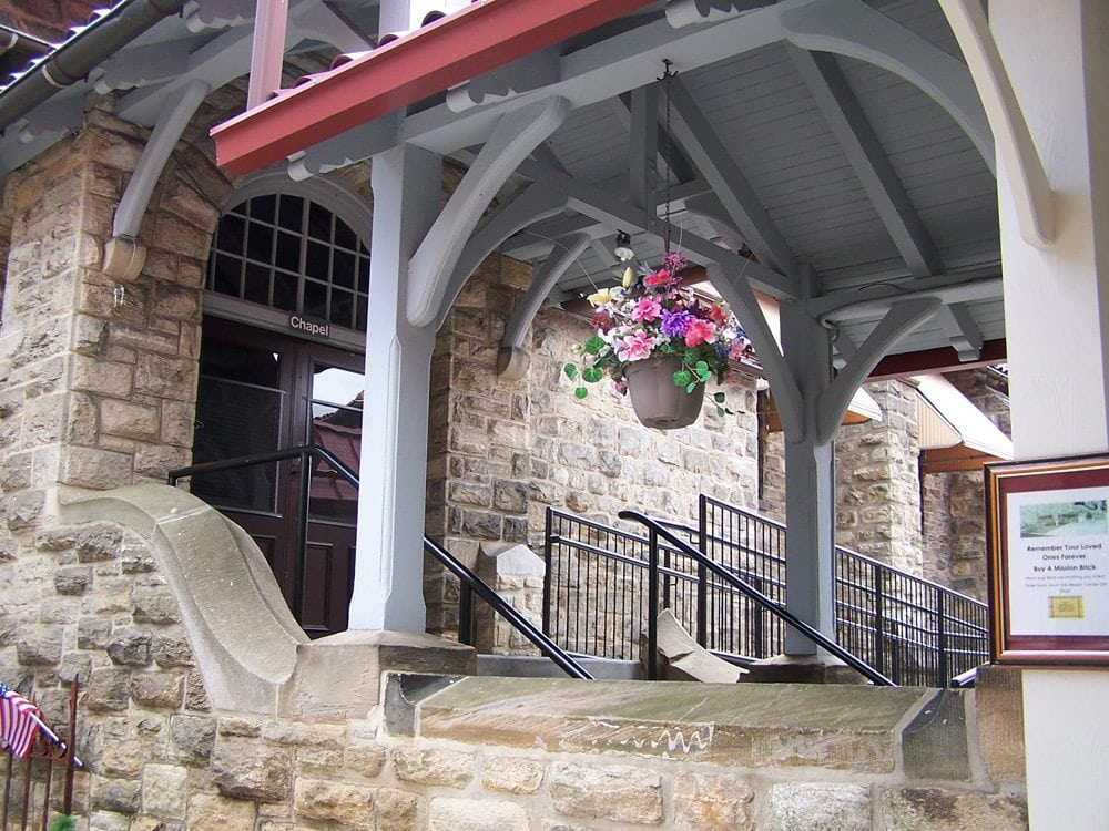 A flower basket welcomes visitors to the Chapel.