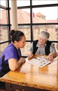 Sr. Annette O'Donnell in a tutoring session with Janet Ruiz.