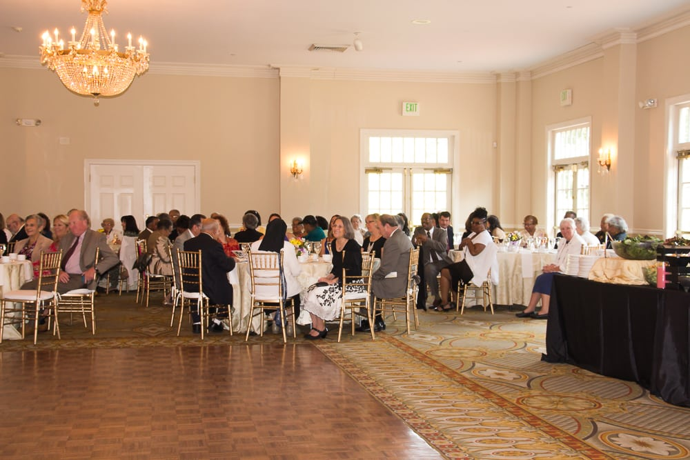 Guests are seated at tables surrounding the dance floor in the lovely dining room.
